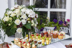 Flowers bouquet and tray canapes Stock Photos