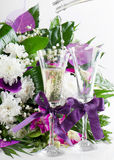 Flowers bouquet and two glasses Stock Photo
