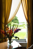 Flowers bouquet at a window over Cheverny garden Stock Photography