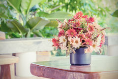 Flowers bouquet on woo table Royalty Free Stock Images