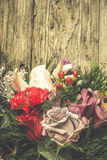 Flowers bouquet on wooden Royalty Free Stock Images
