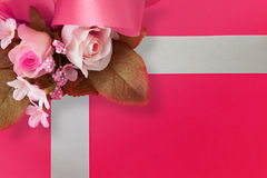 Flowers On a Box. A bunch of artificial flower on a present box Stock Images