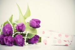 Flowers and box. Retro photo Stock Photo