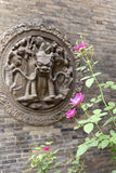 Flowers and brick carving Stock Images