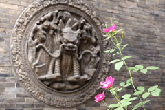 Flowers and brick carving Royalty Free Stock Images