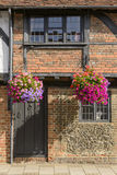 Flowers, bricks and wattle house, Henley on Thames Royalty Free Stock Image