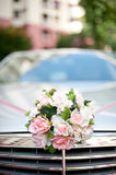 Flowers on a bridal car Stock Image