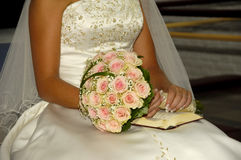 Flowers and bride. Bride is sitting with her bouquet Stock Photography