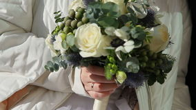 Flowers in the bride's hands stock footage
