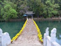 Flowers bridge lake Royalty Free Stock Photography