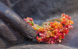 Flowers and bronze Stock Image