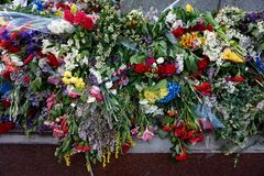 Flowers brought by people to the burning `Eternal Fire` on Victory Day over fascism, May 9.  Royalty Free Stock Images