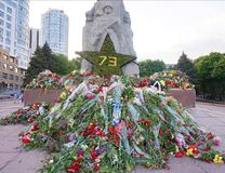 Flowers brought by people to the monument of Glory on Victory Day over fascism, May 9.  Royalty Free Stock Photography