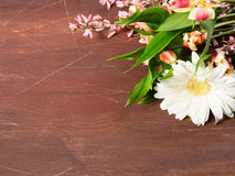 Flowers on brown wooden table Stock Photos