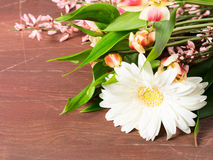 Flowers on brown wooden table Royalty Free Stock Photo