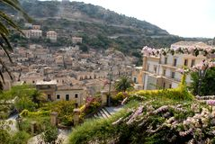 Flowers, building and roofs of houses in Ragusa Ibla in Sicily Royalty Free Stock Photo