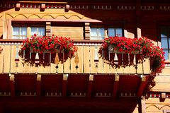 Flowers on building in swiss village Royalty Free Stock Photo