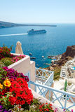 Flowers, buildings and cruise ship in Oia, Santorini Stock Image