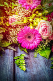 Flowers bunch with gerbera and roses on blue wooden background Royalty Free Stock Photo