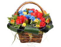 Flowers bunch wicker basket, with red roses and blue chrysanthe stock image