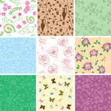 Flowers and butterflies on seamless patterns - vector backgrounds. Flowers and butterflies on seamless patterns - set of vector backgrounds Royalty Free Stock Images