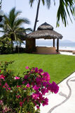 Flowers cabana. Beautiful Cabana surounded by flowers and ocean Stock Images