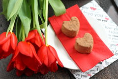 Flowers and cake in the Valentines Day Royalty Free Stock Photos