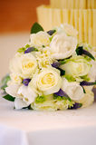 Flowers and cake at wedding. Yellow roses decorate cake table at wedding Stock Images