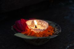 Flowers and candle for Ganga Aarti ritual Stock Photo