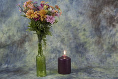 Flowers by candle light Stock Photos