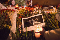 Flowers and candle lights for terroristic attacks victims in Paris Stock Image