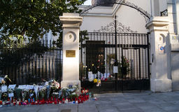 Flowers, candles and signs against terrorist attack in Paris, placed in front of French embassy in Madrid, Spain Royalty Free Stock Images