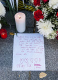 Flowers, candles and signs against terrorist attack in Paris, placed in front of French embassy in Madrid, Spain Stock Photo
