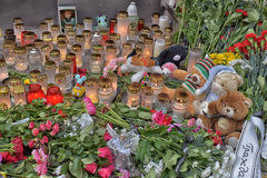 Flowers, candles and toys at the Russian embassy in Talline- tribute to those killed in plane crash Stock Photo