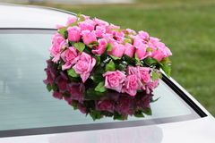 Flowers on a car. Stock Photo
