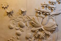 Flowers carved sandstone Stock Image