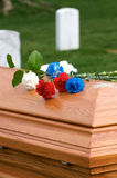 Flowers on casket. Arlington National Cemetery with flowers on casket and gravestones in background Royalty Free Stock Photos