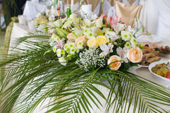 Flowers and celebratory table. Stock Photos