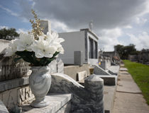 Flowers at a Cemetary in New Orleans. A marble vase holds flowers Royalty Free Stock Photography