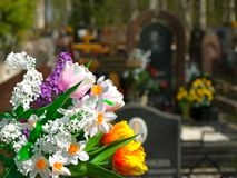 Flowers and cemetery. On background Royalty Free Stock Photography