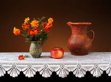 Flowers in a ceramic vase and fruit Royalty Free Stock Photo