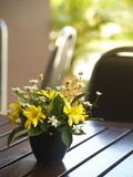 Flowers in a ceramic vase on a wooden table Stock Photography