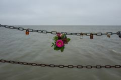 Flowers at a chain in Wilhelmshaven Royalty Free Stock Photography