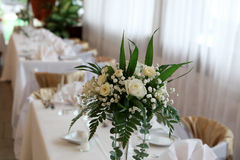 Flowers and chairs. Many chairs and flowers in a ballroom for weddings Stock Photography