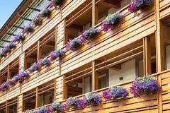 Flowers on Chalet balcony Stock Photos