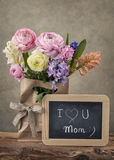 Flowers and a chalk board Stock Photo