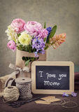 Flowers and a chalk board. Flowers and a black chalk board Royalty Free Stock Photos