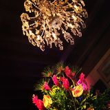Flowers and a chandelier stock image