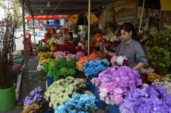 Flowers for the Chinese New Year. People shopping for flowers to be used as offerings and decorations for the coming Chinese New Year Stock Photo