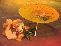 Flowers and Chinese umbrella. In a stage Stock Photography